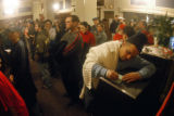 (DENVER, Colo., Nov. 2, 2004) Voting lines  Photo by RICK GIASE/SPECIAL TO THE NEWS Mike Lear...