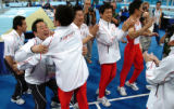 (ATHENS, GREECE- AUGUST 17, 2004)  Members of Japan's men's gymnastics team jump for joy after...