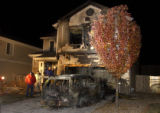 Aurora, Colo.-November 18,2004- Restoration workers examine the remains of a house fire where...