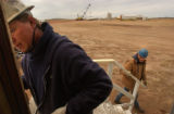 [(Gillette, WY, Shot on: 11/10/04)] Hladky Construction employees Kieth Riggle (left) and Guy...