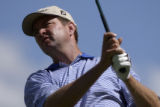 (Castle Rock, Colo., August 3, 2004) Davis Love III tees off on the eighth hole during a practice...