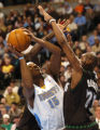 (Thornton, Colo., November 4, 2004) Carmelo Anthony fights his way past Trenton Hassell in the...