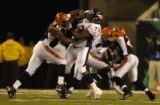 (Cincinnati, OH, October 25, 2004) Duane Clemons, of the Bengals, pushes back George Foster as...