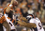 (Cincinnati, Colo, October 25, 2004) Denver Broncos vs.Cincinnati Bengals.  Al Wilson stuffs QB...