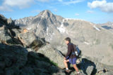 "David ""Dave"" Williams climbs Notch Mountain with the Mount of the Holy Cross looming in..."