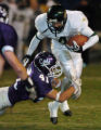 (ARVADA, CO., NOVEMBER 5, 2004) Arvada West's #41, Tim Marshburn, left, wraps up the legs of Bear...