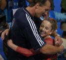 (Athens, Greece  on Wednesday, Aug. 19, 2004) - Gymnastics coach Evgeny Marchenko, left, hugs...