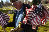 11/05/2004 Denver, Colorado-Vietnam Veteran Terry Goad, a member of VFW Post 9644 places flags on...