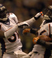 Linebacker Al Wilson #56 and corner back Kelly Herndon #31 of the Denver Broncos celebrate in the...