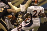 New Orleans Saints quarterback Aaron Brooks tumbles into the end zone for an apparent touchdown in...