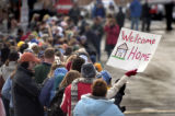 "(Arvada, Colo., November 21, 2004) A member of the crowd holds a sign that says ""Welcome..."