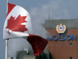 July 22, 2004. Steam blows past a giant Canadian flag in front of Molson's flagship Toronto...