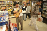 "[Denver, CO - Shot on: 10/25/04] One man mariachi band Juan Vergara, 68, sings ""Beautiful..."