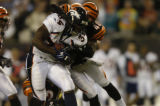 (Cincinnati, Ohio, October 25, 2004)Droughns is tackled in the 2nd for a short bgtainGame action...