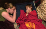 (Craig, Colo., November 9, 2004) Brandy Hixson, left, says a prayer with her son, Gregory Hixson,...
