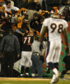 (Cincinnati, Ohio, October 25, 2004) Willie Anderson and a group of Bengals fans celebrate a...