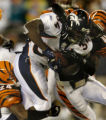 (Cincinnati, Ohio, October 25, 2004) Reuben Droughns is tackled by Deltha O'Neal, left, and ...