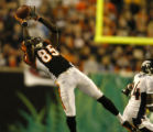 (Cincinnati, Ohio, October 25, 2004) Chad johnson makes a leaping catch over Champ Bailey in the...