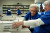 10/27/2004 Golden-Lenore Bible, left, and Miriam Rusley process absentee ballots at the Jefferson...