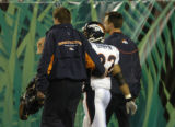 (Cincinnati, Ohio, October 25, 2004) Quentin Griffin is escorted off the field in the third...