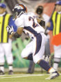 (Cincinnati, Colo, October 25, 2004) Denver Broncos vs.Cincinnati Bengals.  Quentin Griffin runs...