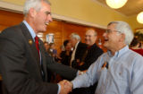 (FT. COLLINS, Colo., October 27, 2004) U.S. Senate candidate Peter Coors, shakes hands with House...