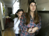 (LAKEWOOD, Colo., March 1, 2005) Charlotte Morris and her daughter Alana, 7,  stand in their...
