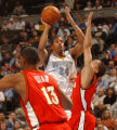 Denver, Colo., photo taken March 1, 2005- Nuggets guard, Andre Miller (center), shoots over...