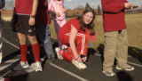 (ENGLEWOOD, Colo., February 14, 2005) Mary Faley stops to tie her shoe between laps. (red outfit...