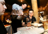 (DENVER, Co. - Shot 2/22/2005) Barolo Grill sommelier and general manager Ryan Fletter (center) of...