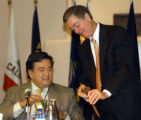 NMJG102 - Colorado Gov. Bill Owens, right, talks with New Mexico Gov. Bill Richardson, left, after...