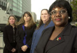 NY838 - ** FILE ** Betty Dukes, right, lead poses with fellow plaintiffs shortly before a hearing...