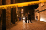 03/02/2005 Chicago-A detective talks with a Chicago police officer in the alley behind the...