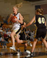 Thorton, Colo., photo taken March 2, 2005- Arapahoe's, Allison Hastings (center black jersey)...