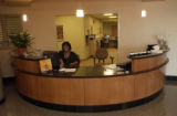 (AURORA, Colo., March 2, 2005) Wanda Robinson, Patient Service Coordinator, works at the front...