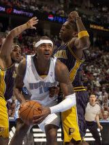 (Denver, CO., March 3, 2005)  The Nuggets' Carmelo Anthony times  his shot against the Pacers'...
