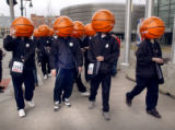 "Denver, Colo., photo taken February 20, 2005- ""Basket Ball Head"" men stand outside the..."
