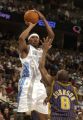 (Denver, CO., March 3, 2005)  The Nuggets' Dermarr Johnson shoots over Indiana's Anthony Johnson...