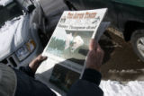 (2/21/05, Aspen, CO)Don Rayburn reads a local paper in front of the Woody Creek Post Office. ...