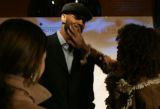 Miami Heat center Alonzo Mourning, center, has his beard touched up by his wife Tracy Mourning,...