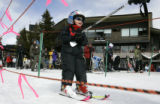 (WINTER PARK, Colo, February 21, 2005) -Ethan Jeanette, 3, gets a tow to the Zephyr lift at Winter...
