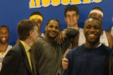 (Denver, Colo., February 17, 2005)  Carmelo Anthony, center,  jokes around by leaning on a...