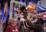 (Denver, Colo., February 17, 2005)  Justin Jones, 1, tries to slam dunk with a little help from...