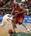 Denver's Erik, Benzel loses control of the ball in the second period with Louisiana-Lafayette's...