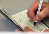 Writing a check from a checkbook
