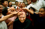 [Denver, CO - Shot on: 5/4/04]  Third grade students have a little fun with professor Rene...