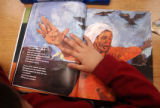 [Denver, CO - Shot on: 5/4/04]  The hand of third grade student Ivan Quintero, 8, rests on a...