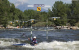 Paul Byers of Salida, Colo., makes his way down the FiBARK slalom course on the Arkansas River...