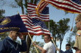 (BRUSH, Colo., May 30-31, 2004)Stan Gray salutes the colors as they are passed by him in the Brush...