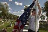 (BRUSH, Colo., May 30-31, 2004) Paul Eicher and Stan, fellow VFW members, work together to remove...